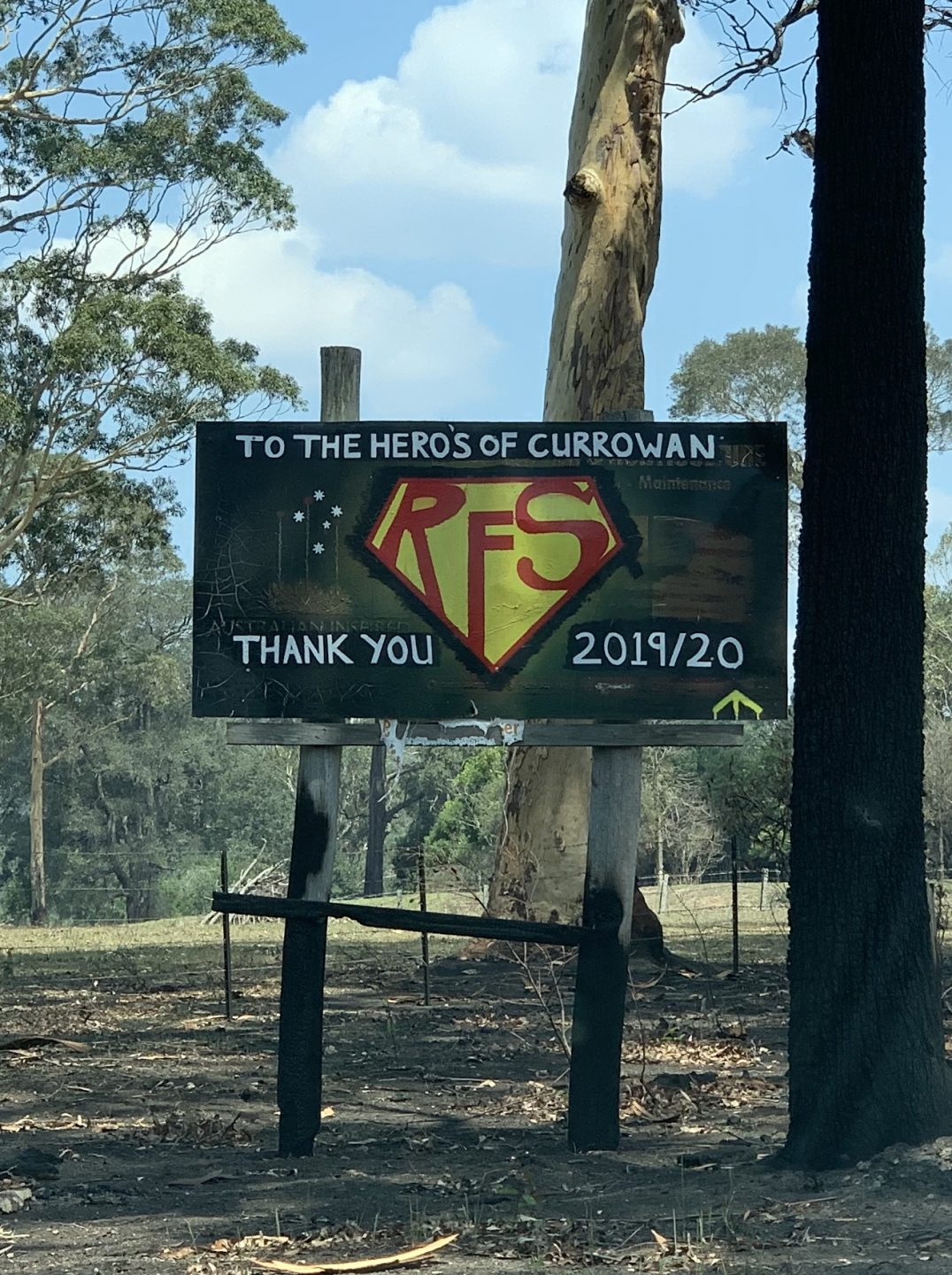 A sign that says 'to the heros of currowan thank you 2019/20' the sign has the letters 'RFS