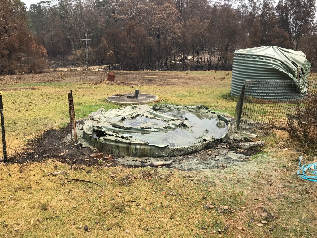 A melted water tank on a rural property