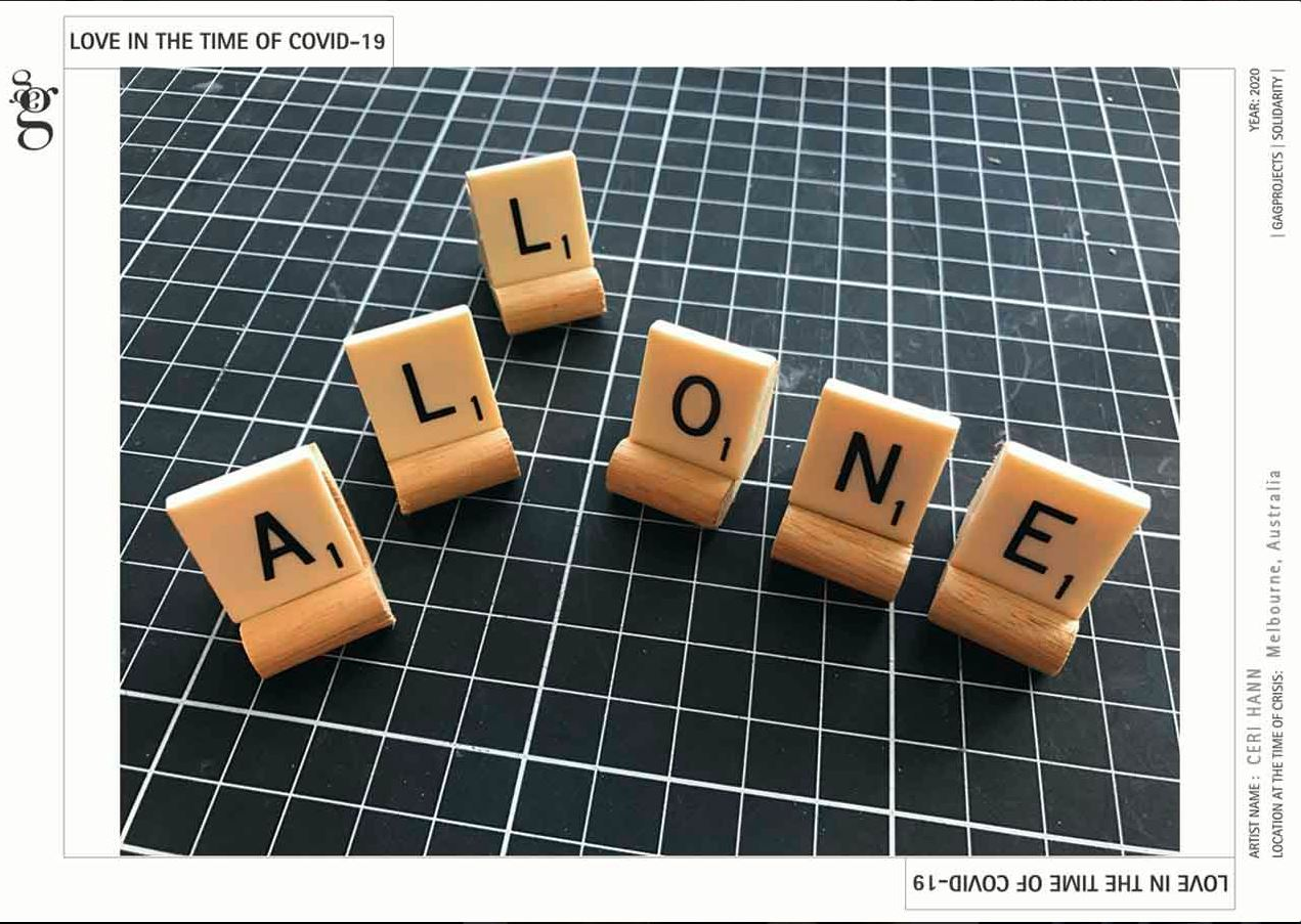 Six scrabble tiles arranged on a dark green with white lines cutting surface. The scrabble tiles read 'all one'