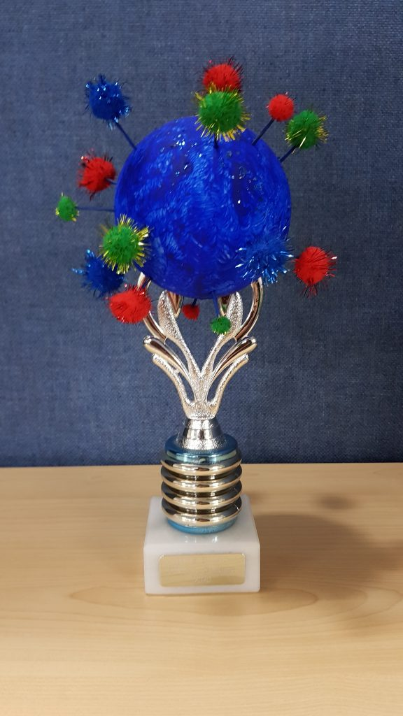 Handmade trophy with sparkly material balls on a silver base