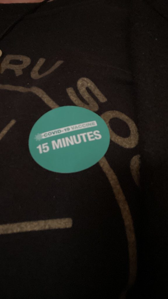 Blue sticker with white lettering reading 15 minutes