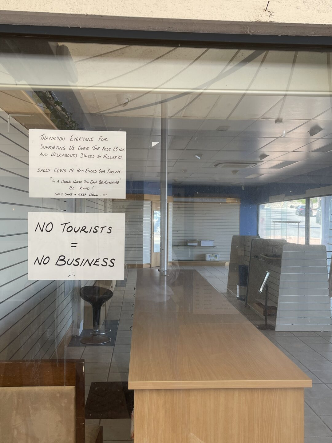 Shop front with a sign reading 'no tourists no business'
