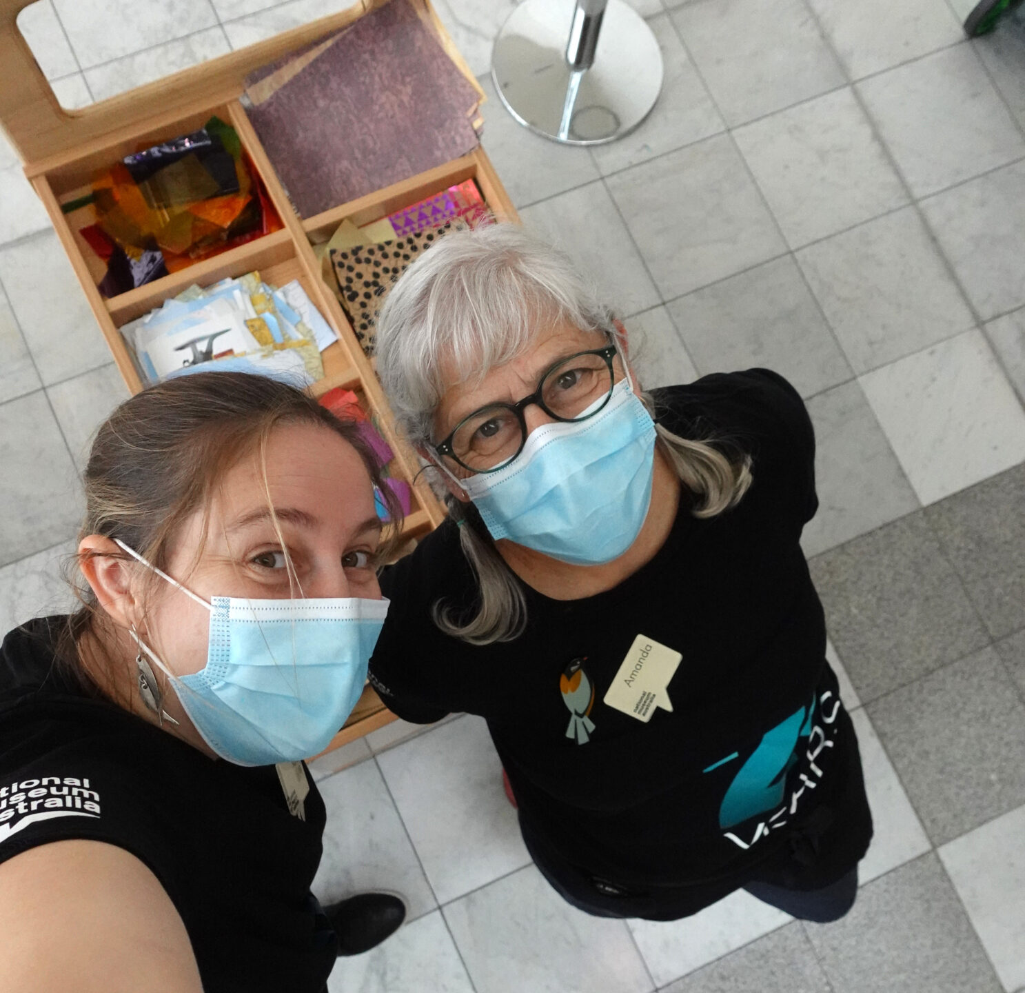 Two women taking a selfie with masks on.