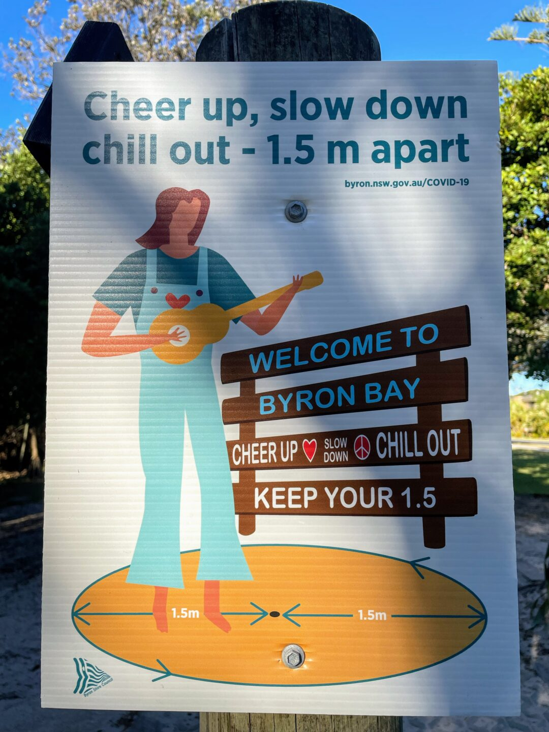 A poster that says 'cheer up, slow down, chill out - 1.5 m apart'