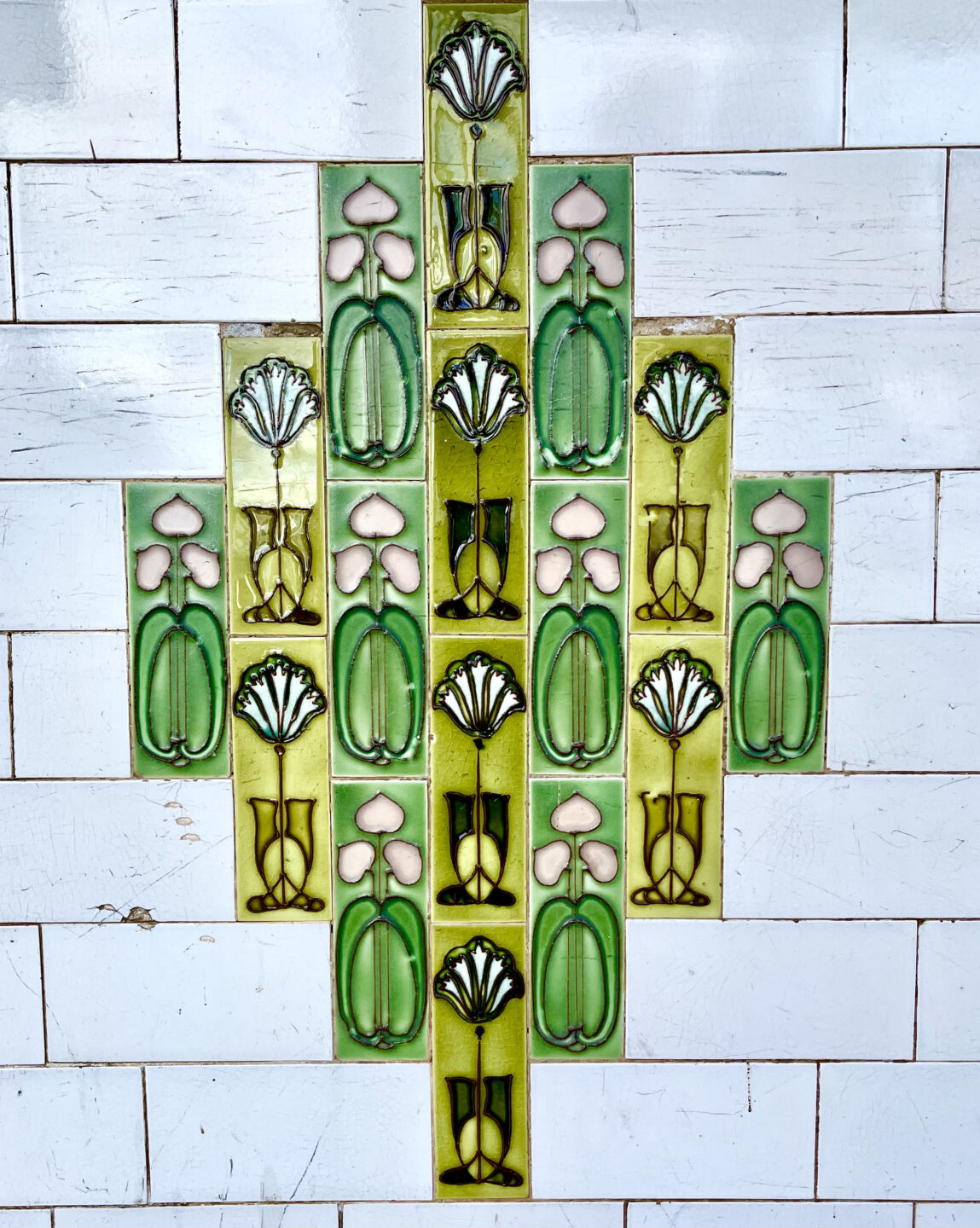 A close up of colourful wall tiles in apple green and lime green.