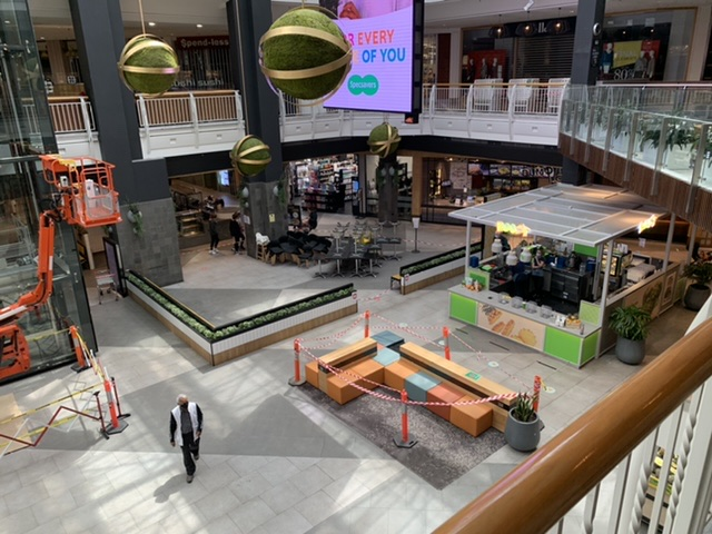 An image of a shopping mall with no people in it.